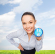 smiling businesswoman with blue clock