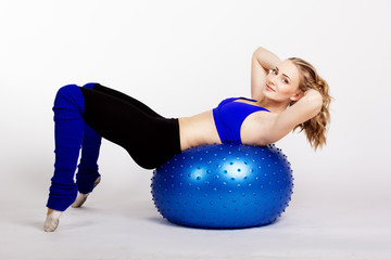 Young woman with fit-ball
