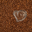 Glass heart on coffee beans