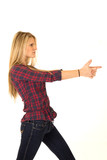 Atttractive female model pretending to shoot a finger gun