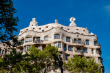 Casa Mila La Pedrera framed by trees at Barcelona