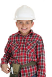 Young boy in a construction hardhat smiling