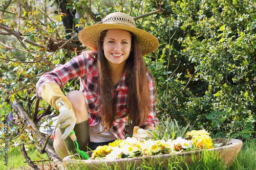 Beautiful young woman enjoying her garden