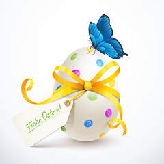 Buntes Osterei mit Schleife, Schmetterling und Etikett