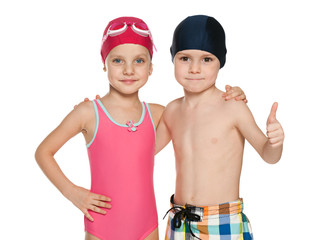 Two smiling children in swimsuits