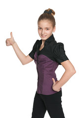 Walking preteen girl holds her thumb up