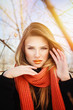 Gorgeous young woman with orange makeup and scarf