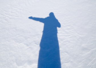 shadow of a man in the snow