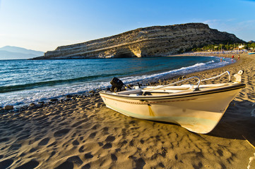 Boat on Matala beach, island of Crete