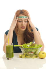 Woman with a centimeter on her head thinking on dieting