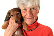 Woman and dachshund puppy