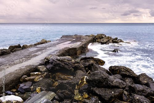 Winter seashore with pier color image