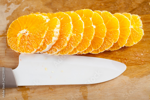 canvas print picture Orange fruit slice. Close-up.