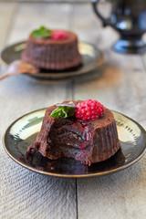 Chocolate fondant lava cake with raspberries and mint