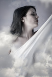 Beautiful woman in clouds, mithology concept. Brunette with long