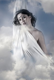 Fly, Beautiful woman in clouds, mithology concept. Brunette with