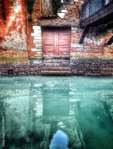 a door under a bridge, Venice