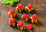 Mini gingerbread squares with melted chocolate