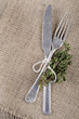fork and knife with thyme