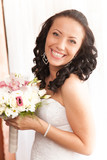 Closeup portrait of beautiful laughing brunette bride