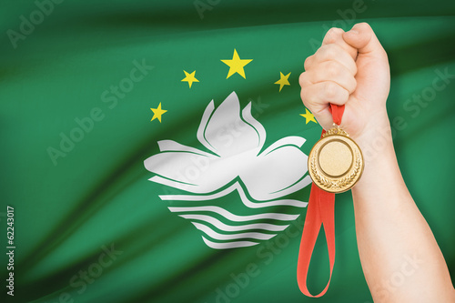 Medal in hand with flag - Macao SAR - People's Republic of China