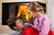 Smiling couple by fireplace