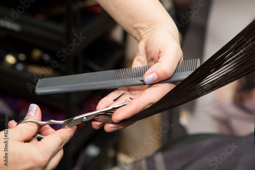 Women's haircut scissors at salon
