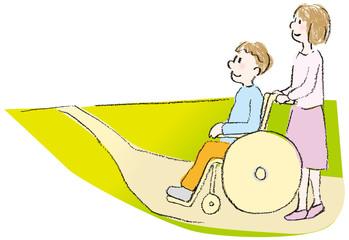 車いすの人と道