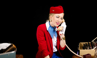 Retro Airline Stewardess Preparing for Work and Talking on the T