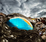 Earth contamination concept. Litter and dramatic sky