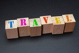 travel word on wood blocks