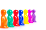 Colorful toy people group looking all in one side
