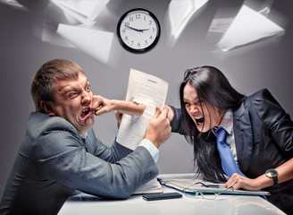 Two office workers starting to fight