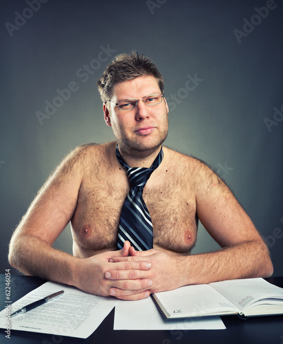 Serious businessman weared necktie looking at camera