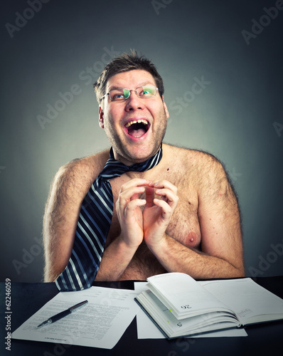 Happy crazy shirtless businessman studio image