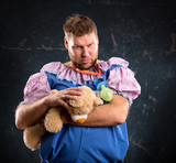 Man with toy bear in studio
