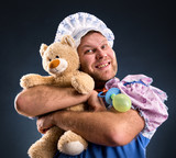 Man and teddy bear in studio