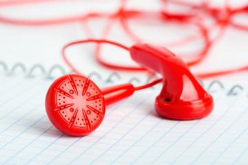 Red headphones on notebook horizontal view