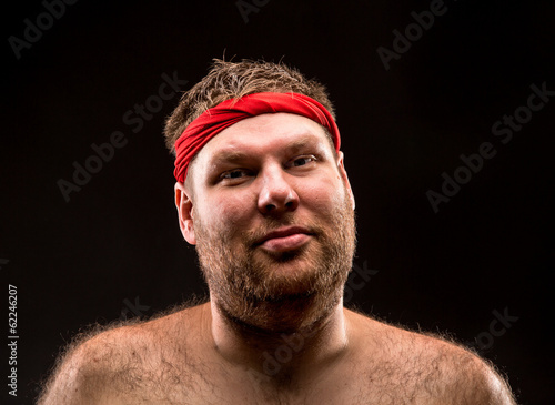 Man with red headband looking at camera