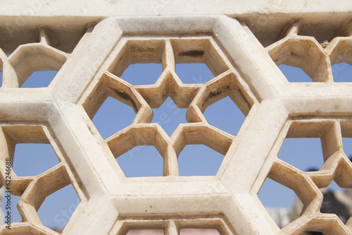 White marble wall with star and hexagon hole pattern