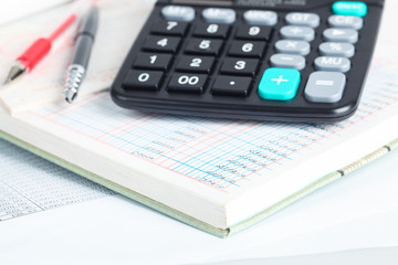 calculator and financial books