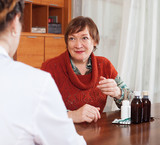 woman complaining to  doctor about feels