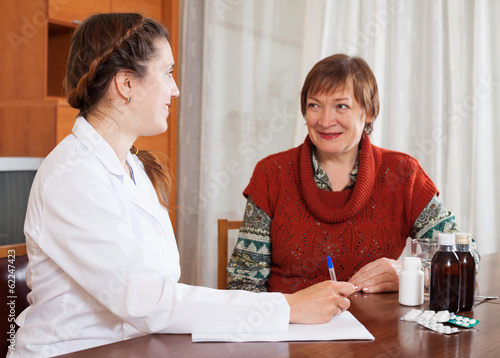 friendly doctor examining mature woman