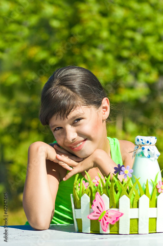 Smiling girl with bottle of milk
