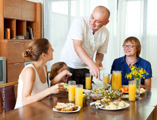 Portrait of happy family together over healthy dining table