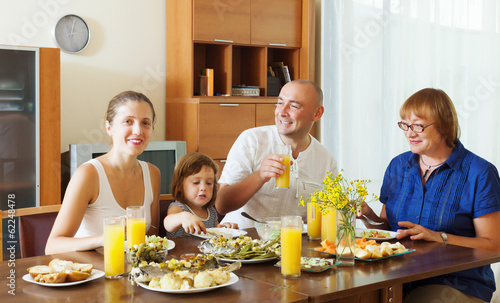 multigeneration family  eating fish with vegetables