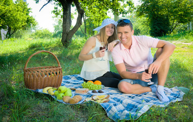 Woman and man on picnic in nature