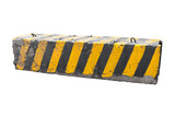 Striped black and yellow concrete road barrier block