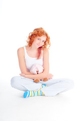 Woman in pajamas with soft toy