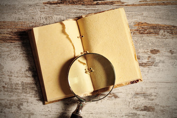 notebook and magnifying glass